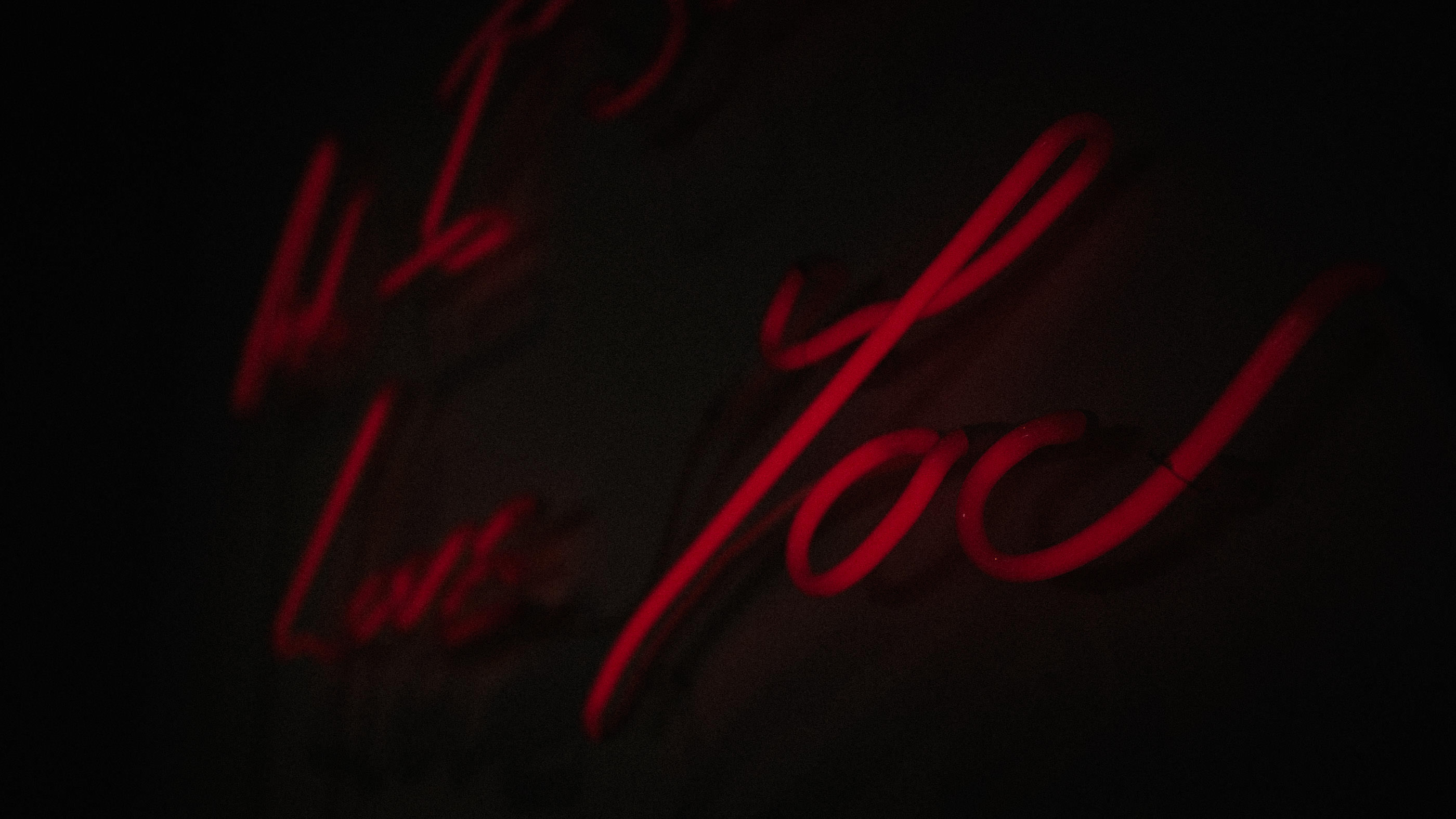 "A neon sign reads ""and I love you"" from a recent alpina gstaad wedding video"