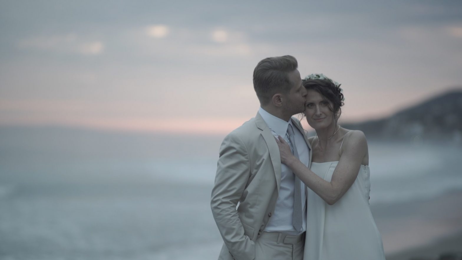 Malibu wedding videographer Philip White capturing a bride and groom on the beach