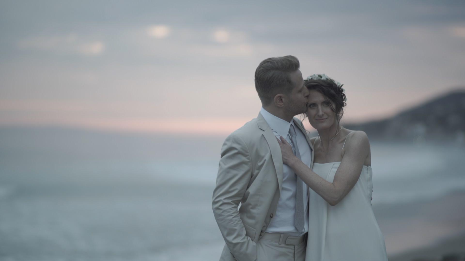 Malibu wedding videographer Philip White capturing a bride and groom on the beach