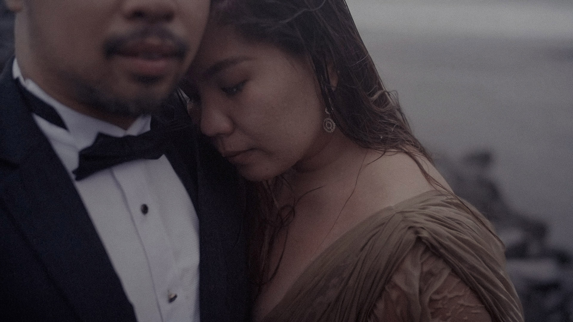 A couple stand soaking wet during one of my Iceland Elopement Video assignments.