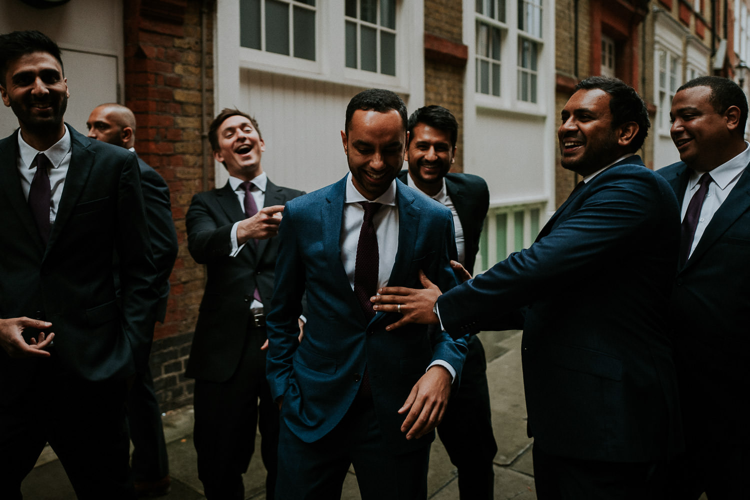 some guys laughing during one of my recent uk wedding videography assignments.