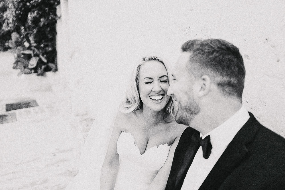 a bride and groom laughing at their Borgo Egnazia wedding in Puglia