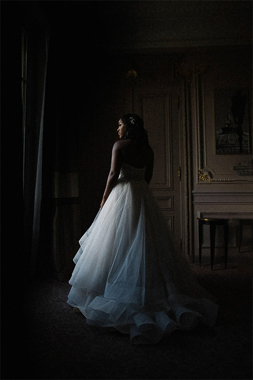 Halima, one of our brides standing in her Paris hotel room.